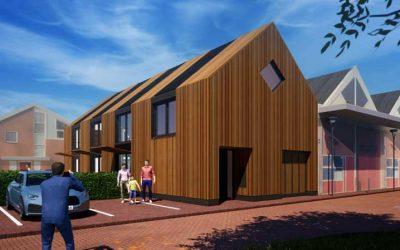 Van bedrijfsgebouw naar woning: nieuwe houten woning maakt rij compleet